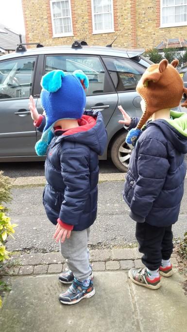 boys waving