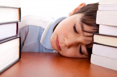 school-boy-sleeping-on-table