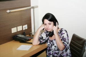 Business woman having boring call in office